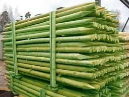 Rounded pine pillars, fences, palisades